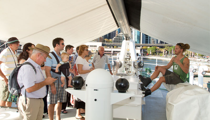 Crewman Nick talks with visitors to the ship